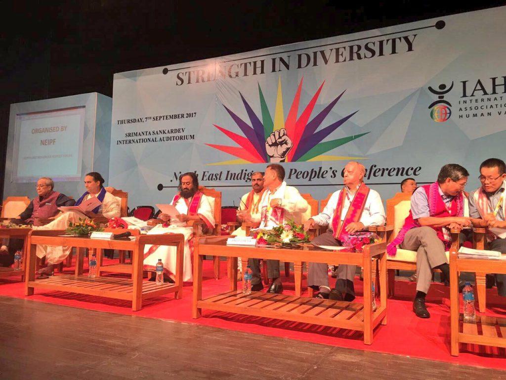 Sri-Sri-Ravi-Shankar-Strength-in-Diversity-North-East-conference-stage-sitting